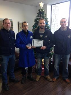 Renatas Vaitekunas is presented his Employee iof the Year Award in the Potato Division by Thomas Clarke, Radek Krol and Philip Meade Jr.
