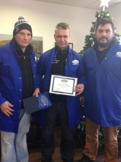 Boguslaw Wolloch accepts his Employee of the Year Award 2015 in the Fruit Division from Ronan McDonagh and James Sheehy.