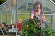 Joanne in the green house